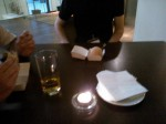Burger compared to a small tea candle