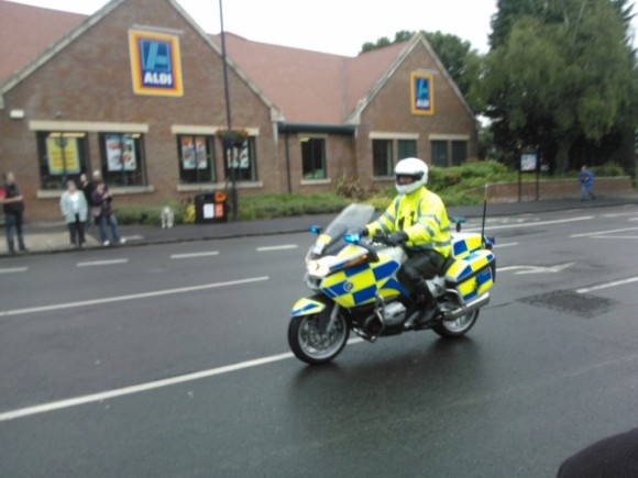 Police Motorcycle - He later went on to 'High 5' members of the crowd!