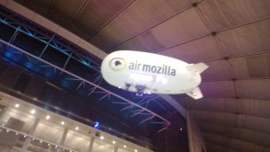 The Air Mozilla Blimp passes above the Microsoft Stand