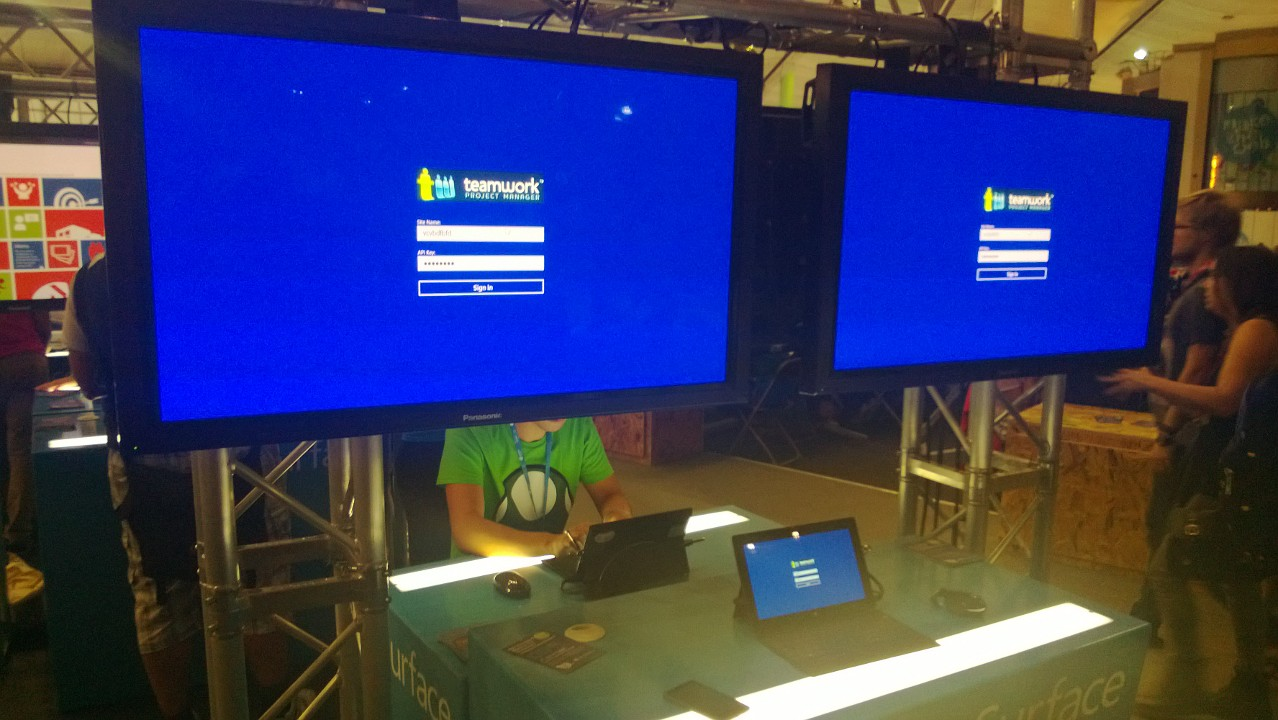 The TeamworkPM App for Windows 8 I developed on the 2 big displays and the Surface Pro I wrote it on