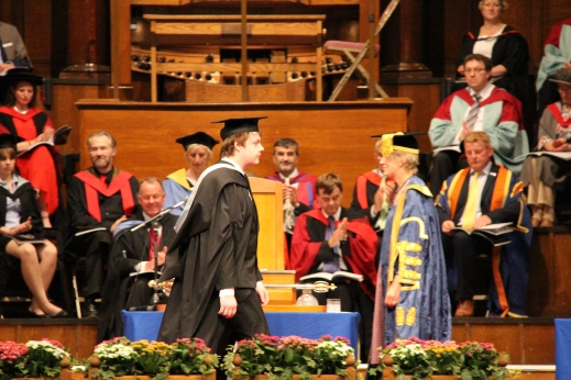 Walking past the chancellor as part of the graduation ceremony